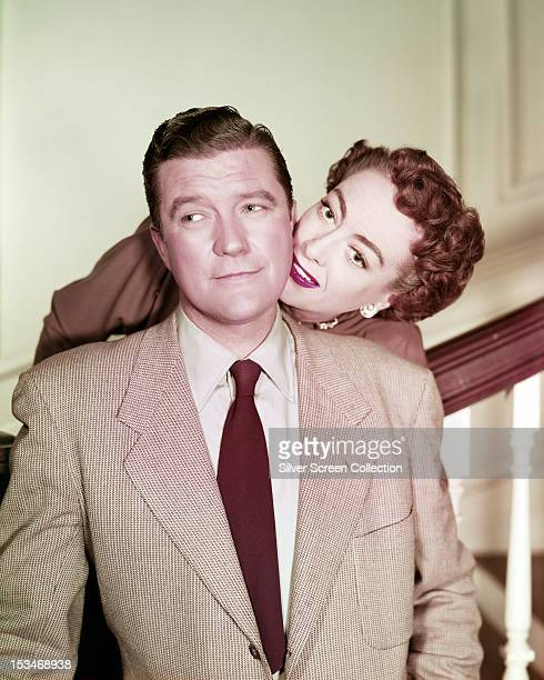 American actors Dennis Morgan and Joan Crawford in a publicity still for the film 'This Woman is Dangerous' 1952