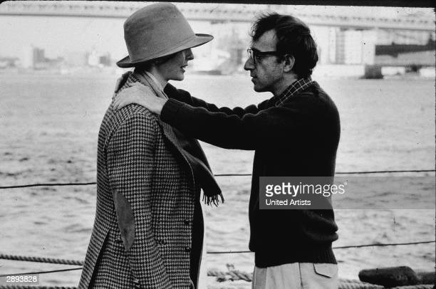 American actors Diane Keaton and Woody Allen in a scene from 'Annie Hall' directed by Allen New York New York 1977 Allen has his hands on Keaton's...