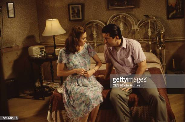 American actors Diane Lane and Alec Baldwin sit side by side on a bed in a scene from the television production of 'A Streetcar Named Desire' the...