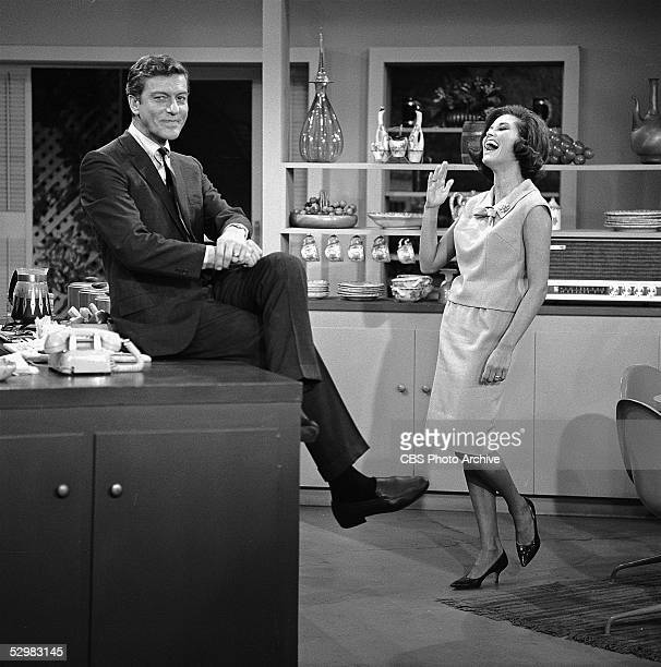 American actors Dick Van Dyke and Mary Tyler Moore share a humorous moment on an episode of 'The Dick Van Dyke Show' Culver City California 1963 Van...