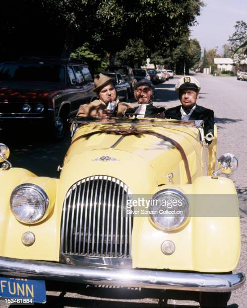 American actors Dom DeLuise Marty Feldman and Mel Brooks in a Morgan sports car in a scene from 'Silent Movie' directed by Brooks 1976