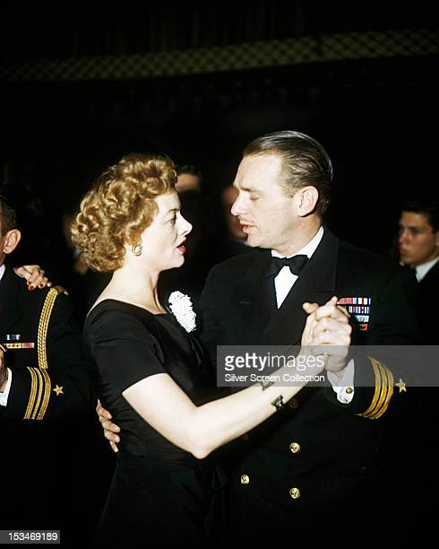 American actors Douglas Fairbanks Jr and Myrna Loy dancing together circa 1944 Fairbanks a US Navy captain is in dress uniform