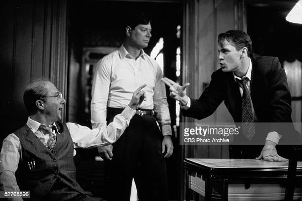 American actors Dustin Hoffman and John Malkovich argue in front of Stephen Lang in a stagedfortelevision version of the Arthur Miller play 'Death of...