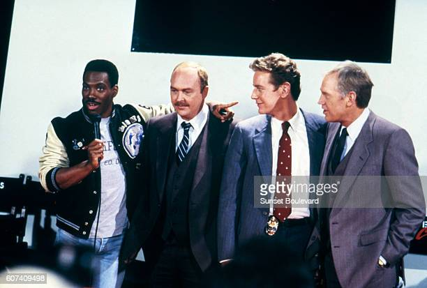 American actors Eddie Murphy, John Ashton, Judge Reinhold and Ronny Cox on the set of Beverly Hills Cop II, directed by Tony Scott.