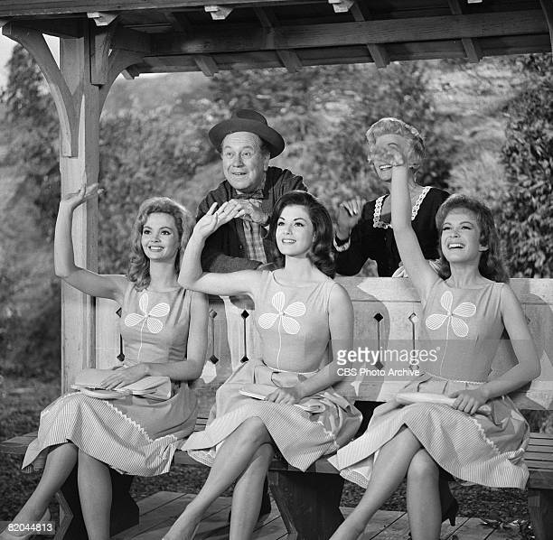 American actors Edgar Buchanan Bea Benaderet and front row from left American actresses Linda Henning Jeannine Riley and Pat Woodell wave from a...