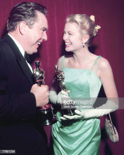 American actors Edmond O'Brien and Grace Kelly celebrate their wins at the Academy Awards in Los Angeles, 30th March 1955. O'Brien won Best...