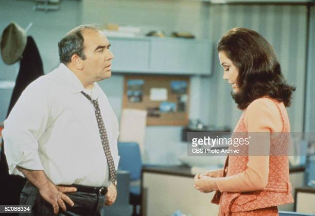 American actors Edward Asner and Mary Tyler Moore in a scene from 'The Mary Tyler Moore Show' , Los Angeles, California, 1970.