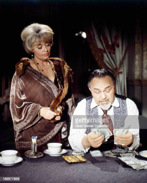 American actors Edward G Robinson as Lancey 'The Man' Howard and Joan Blondell as Lady Fingers in 'The Cincinnati Kid' directed by Norman Jewison 1965