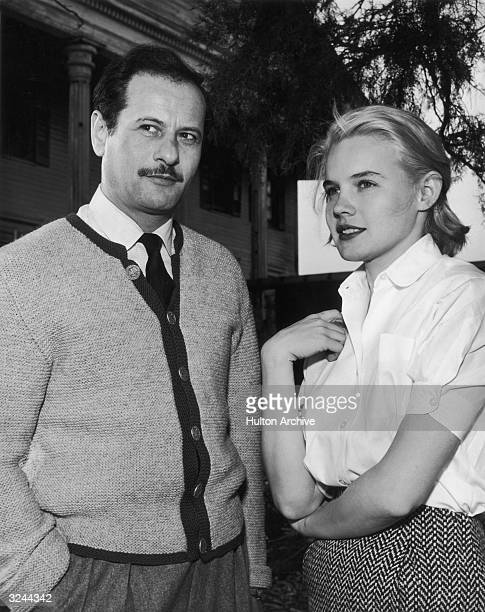 American actors Eli Wallach and Carroll Baker stand together on the set of director Elia Kazan's film 'Baby Doll' on location in Mississippi