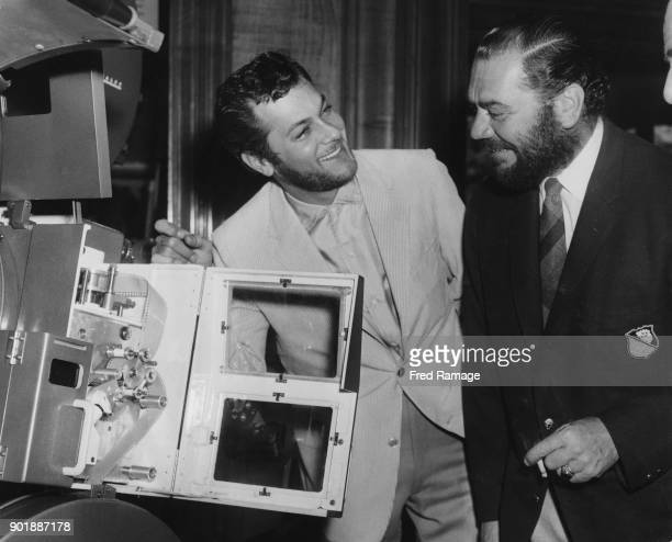 American actors Ernest Borgnine and Tony Curtis attend a demonstration of the Technirama projection system at the Odeon Cinema in Leicester Square...
