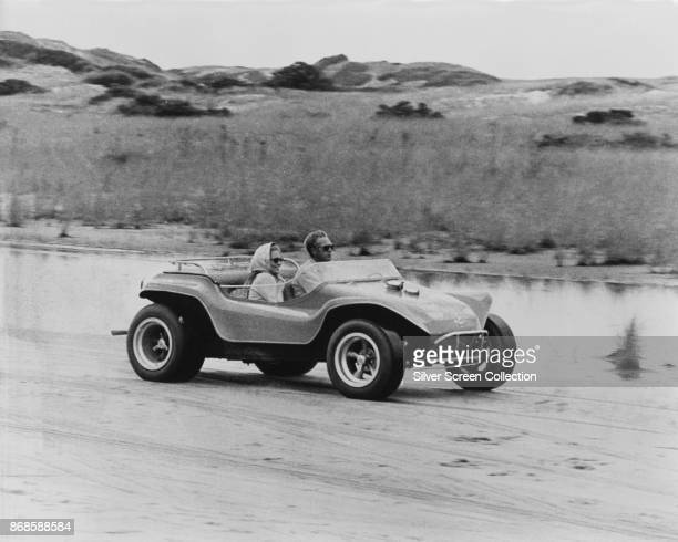 American actors Faye Dunaway and Steve McQueen in a dune buggy on a beach in a scene from 'The Thomas Crown Affair' Massachusetts 1968