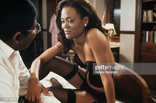 American actors Forest Whitaker as Jackson and Robin Givens as Imabelle in a scene from 'A Rage in Harlem' directed by Bill Duke 1991