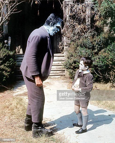 American actors Fred Gwynne as Herman Munster and Butch Patrick as Eddie Munster in the TV comedy horror series 'The Munsters' circa 1965