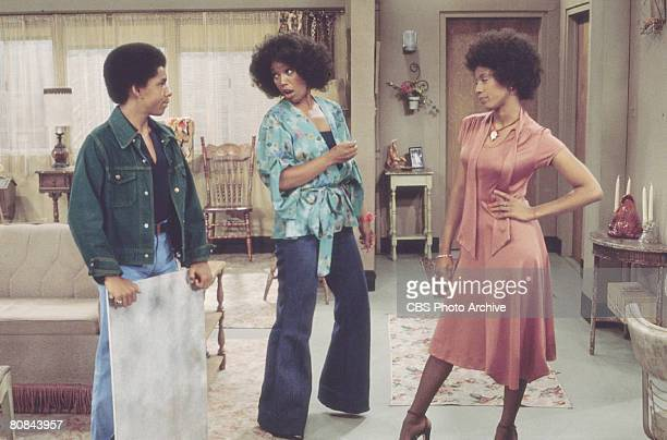 American actors from left Ralph Carter Ja'net DuBois and BernNadette Stanis in a scene from the television series 'Good Times' Los Angeles California...