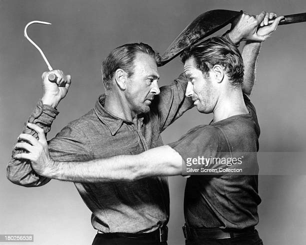 American actors Gary Cooper and Charlton Heston in a promotional still for 'The Wreck Of The Mary Deare' directed by Michael Anderson 1959 Cooper and...