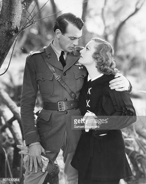 American actors Gary Cooper and Joan Crawford on the set of Today We Live directed by Howard Hawks and Richard Rosson