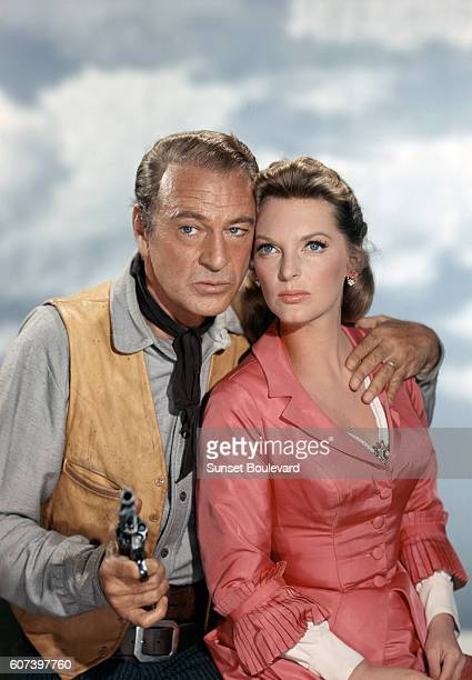 American actors Gary Cooper and Julie London on the set of Man of the West, based on the novel by Will C. Brown and directed by Anthony Mann.