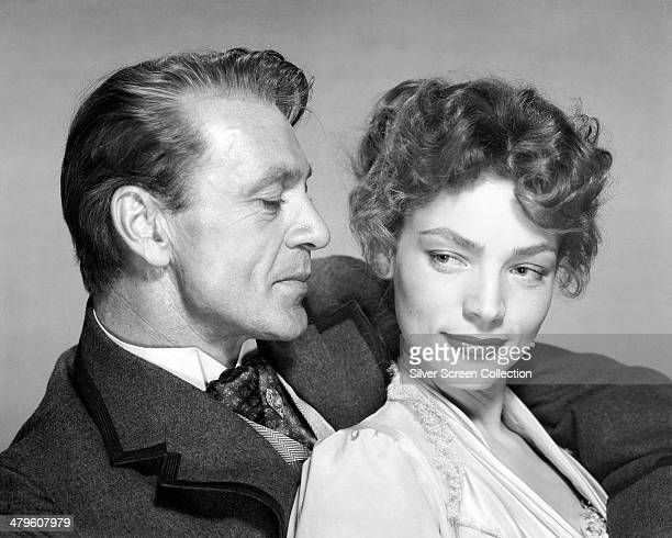 American actors Gary Cooper and Lauren Bacall in a promotional portrait for 'Bright Leaf' directed by Michael Curtiz 1950