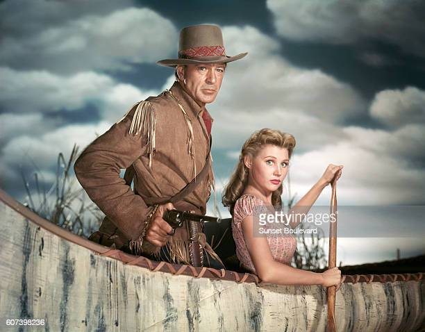 American actors Gary Cooper and Mari Aldon on the set of Distant Drums, directed by Raoul Walsh.