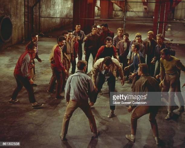 American actors George Chakiris , Richard Beymer , and Russ Tamblyn , along with other cast members, in a scene from 'West Side Story' , 1961.