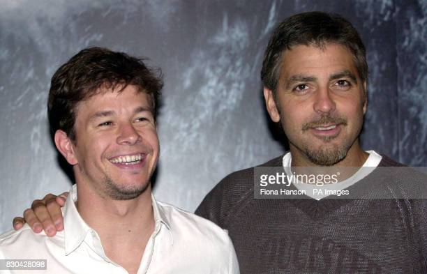 """American actors George Clooney and Mark Wahlberg attending the UK premiere of their latest film """"The Perfect Storm"""", at the Warner Village cinemas,..."""