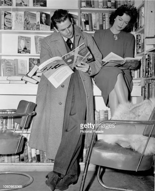 American actors Glenn Ford and Eleanor Powell reading in Martindale's Bookstore in Beverly Hills California 4th February 1943 The two were married...