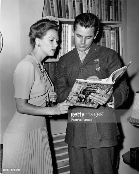 American actors Glenn Ford and Eleanor Powell reading 'You Have Seen Their Faces' a photography book by Margaret BourkeWhite and Erskine Caldwell...