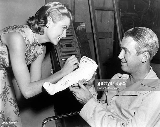 American actors Grace Kelly and James Stewart on the set of Rear Window directed and produced by British Alfred Hitchcock