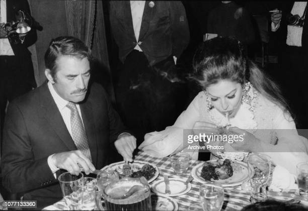 American actors Gregory Peck and Ava Gardner eating fried chicken at a dinner for the benefit of the Free Southern Theater at the Waldorf Astoria in...