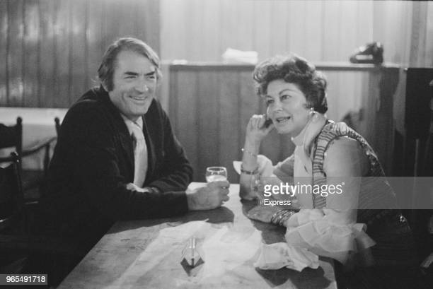 American actors Gregory Peck and Ava Gardner share a glass of wine at a cafe in Earls Court London on 3rd July 1973