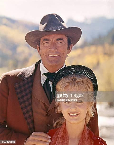 American actors Gregory Peck and Debbie Reynolds on the set of How the West Was Won directed by John Ford Henry Hathaway George Marshall and Richard...