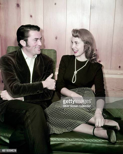 American actors Gregory Peck and Janet Leigh in conversation circa 1955