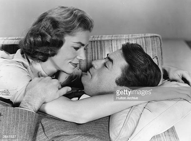 American actors Gregory Peck and Lauren Bacall play a husband and wife in the MGM marital comedy 'Designing Woman' directed by Vincente Minnelli