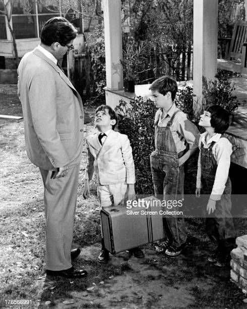 American actors Gregory Peck as Atticus Finch, John Megna as Charles Baker 'Dill' Harris, Phillip Alford as Jem Finch, and Mary Badham as Scout Finch...