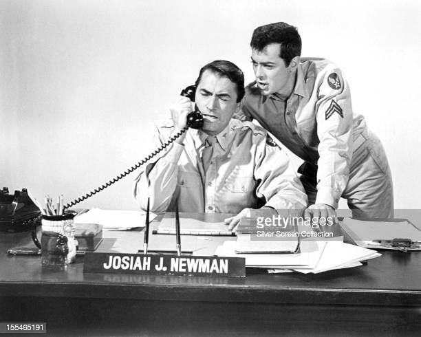 American actors Gregory Peck in the title role, and Tony Curtis as Corporal Jackson Leibowitz in 'Captain Newman, M.D.', directed by David Miller,...