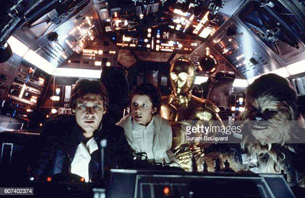 American actors Harrison Ford Carrie Fisher British actors Anthony Daniels and Peter Mayhew on the set of Star Wars Episode V The Empire Strikes Back...
