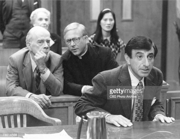 American actors Harry Morgan William Christopher and Jamie Farr appear in a courtroom scene during an episode of the CBS spinoff from 'MASH' called...