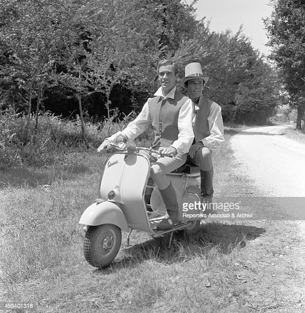 American actors Henry Fonda and Mel Ferrer riding a Vespa in stage costume on the set of the film War and Peace Rome 1955