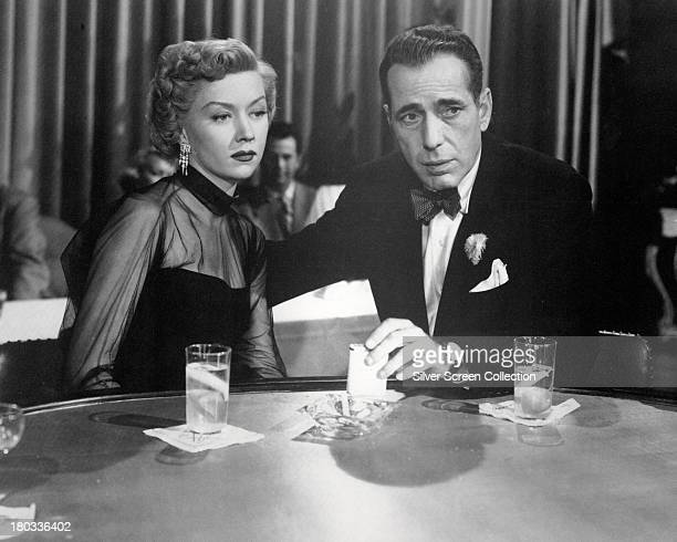 American actors Humphrey Bogart as Dixon Steele and Gloria Grahame 1923 1981 as Laurel Gray in 'In A Lonely Place' directed by Nicholas Ray 1950