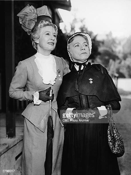 American actors Irene Dunne and Ellen Corby in a publicity still from the 'Doctor Sam' episode of the television series 'Fontier Circus' October 1961