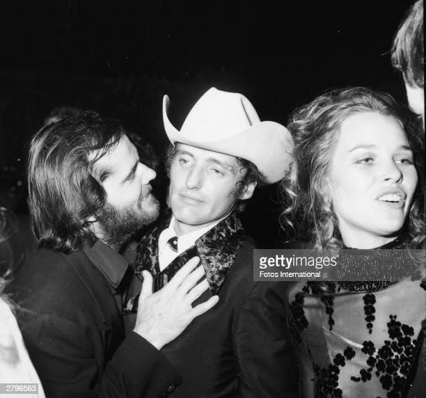 American actors Jack Nicholson and Dennis Hopper talk at an Academy Awards after party Los Angeles California April 1970 Singer Michelle Phillips...