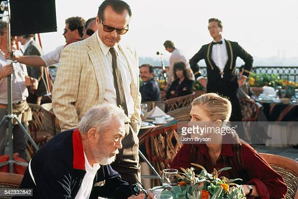 American actors Jack Nicholson and Kathleen Turner and director screenwriter producer and actor John Huston on the set of Huston's movie Prizzi's...