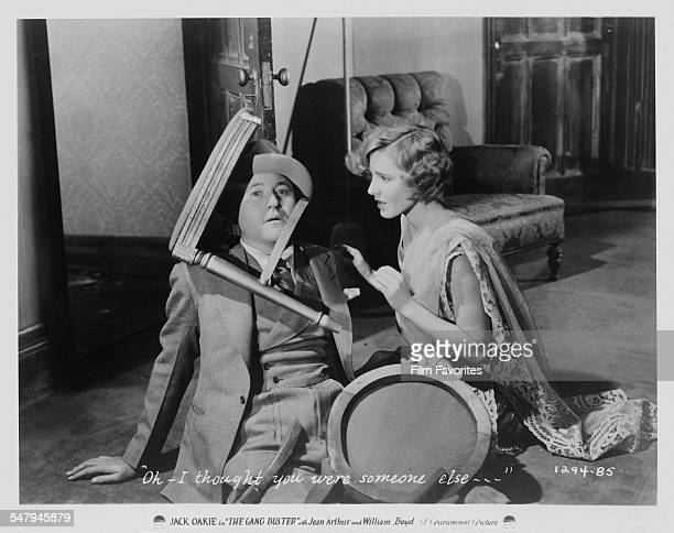 American actors Jack Oakie as 'Cyclone' Case and Jean Arthur as Sylvia Martine in a publicity still for A Edward Sutherland's 1931 comedy 'The Gang...