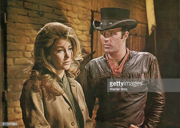 1967 American actors James Caan and Michele Carey wear Western costumes in a still from the film 'El Dorado' directed by Howard Hawk