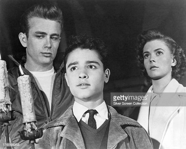 American actors James Dean as Jim Stark Sal Mineo as John 'Plato' Crawford and Natalie Wood as Judy in 'Rebel Without A Cause' directed by Nicholas...