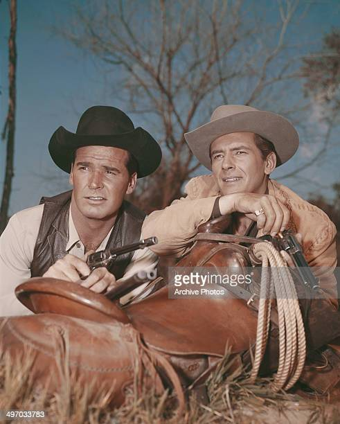 American actors James Garner and Jack Kelly star as Bret Maverick and his brother Bart respectively, in the western television show 'Maverick', circa...