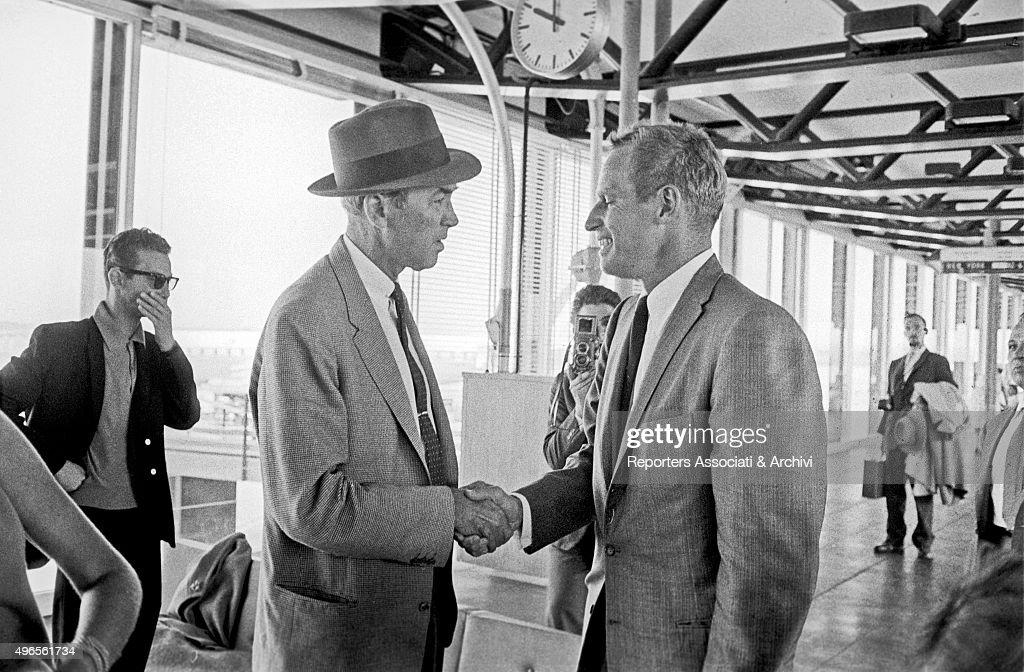 James Stewart and Charlton Heston at Fiumicino Airport : News Photo