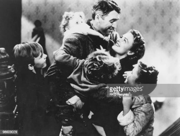 American actors James Stewart and Donna Reed star in the film 'It's a Wonderful Life' 1946 The children are Jimmy Hawkins Karolyn Grimes Larry Simms...