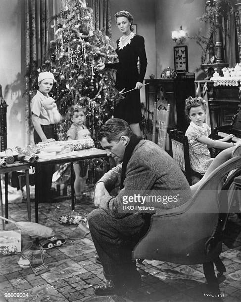 American actors James Stewart and Donna Reed star in the film 'It's a Wonderful Life', 1946. The children are Larry Simms , Jimmy Hawkins and Carol...