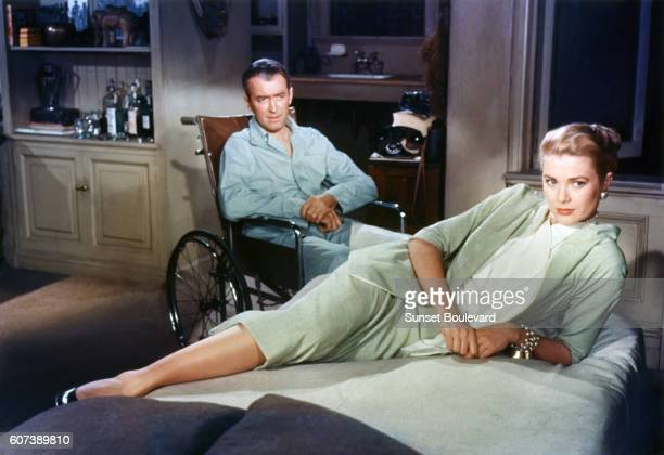 American actors James Stewart and Grace Kelly on the set of Rear Window, directed and produced by British Alfred Hitchcok.